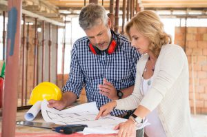 Discussing a home blueprint before investing